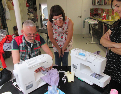 David Mumford with sewing students.