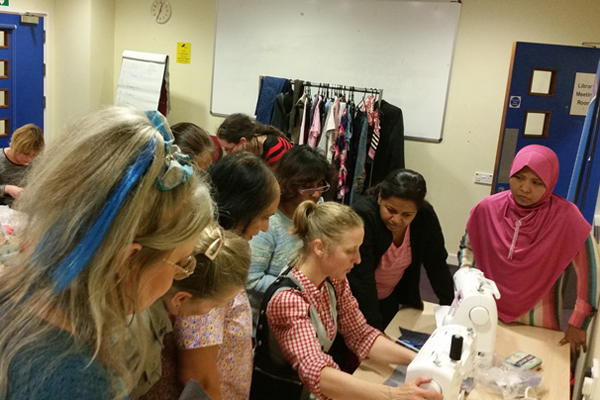 People sewing at a Love Your Clothes workshop.