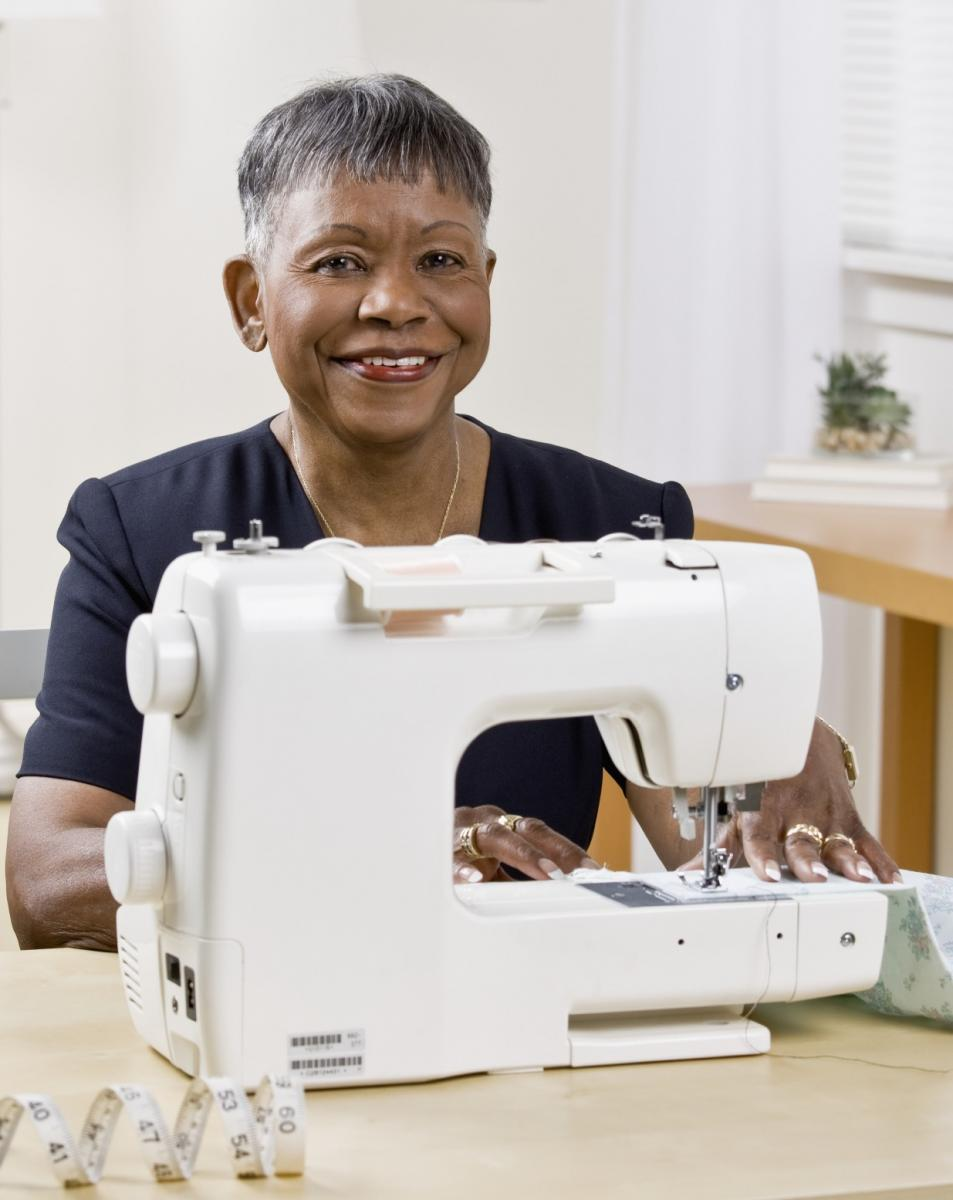 Lady smiling sewing machine_iStock_000012774217_Medium.jpg
