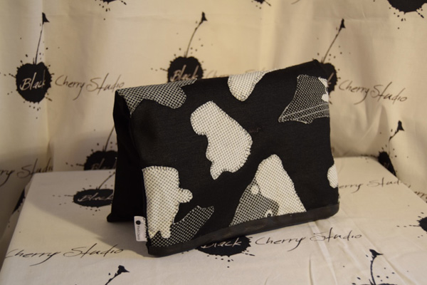 Black, white and grey bag.