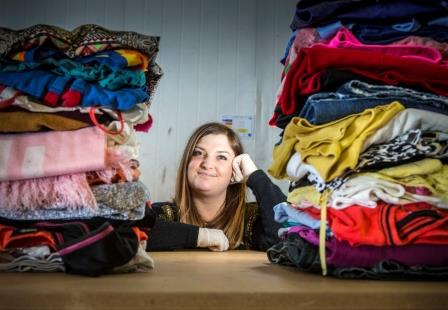 Aimee Kent poses with some of her 150 kilos of unwanted garments.