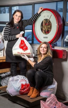 Maxine Dickson left, and Jemma Wood, right pose with their 150 kilos of unwanted garments.