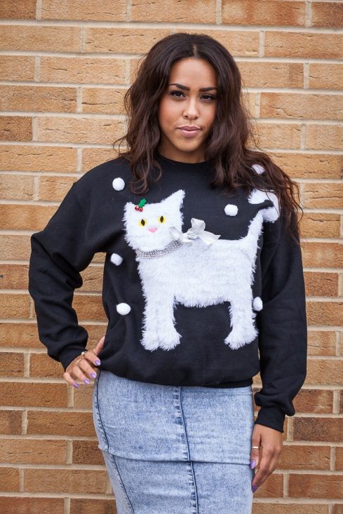 Girl wearing a homemade Christmas kitten sweatshirt