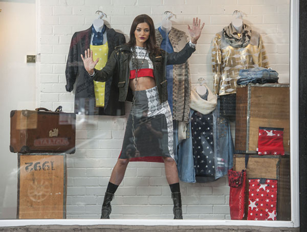 Nicola Mimnagh models the Zero Waste fashion collection in the window of the Salvation Army Trading Company's Glasgow store.