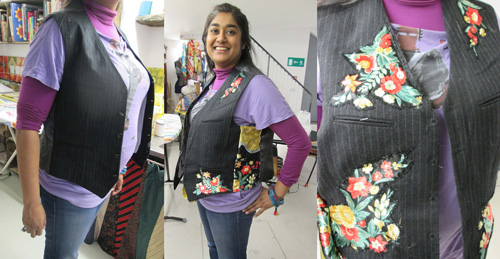 Woman modelling a waistcoat with decorative patches.