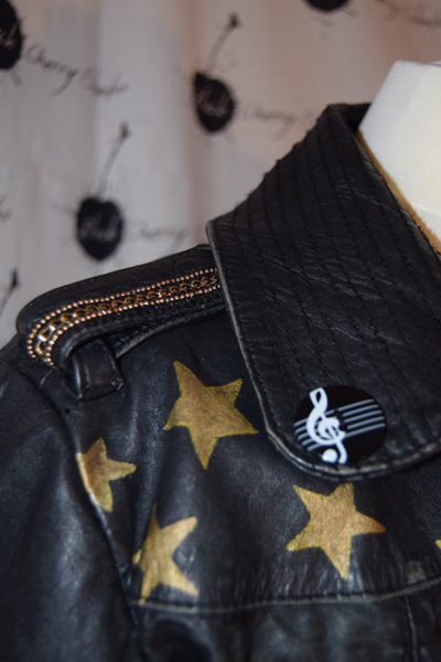 Leather jacket with star and music motifs.