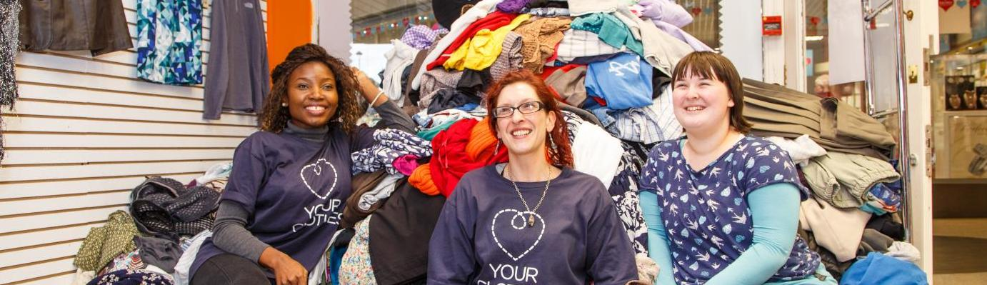 The Love Your Clothes Bangor team with a mountain of donated clothes at our events in Bangor, 2015.