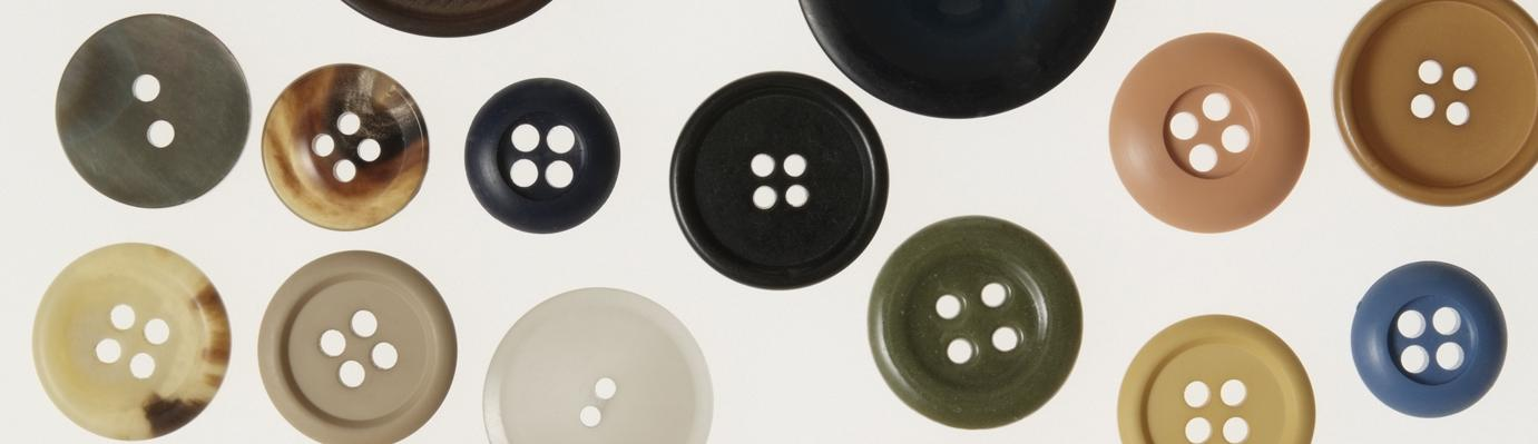 Selection of dark coloured buttons.