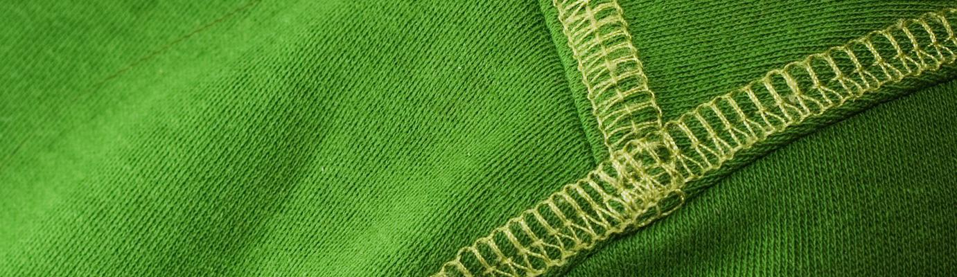 Seams on a green garment.