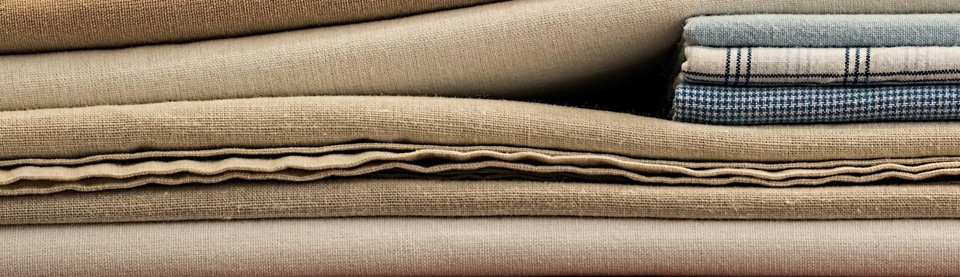 Bales of linen fabric.