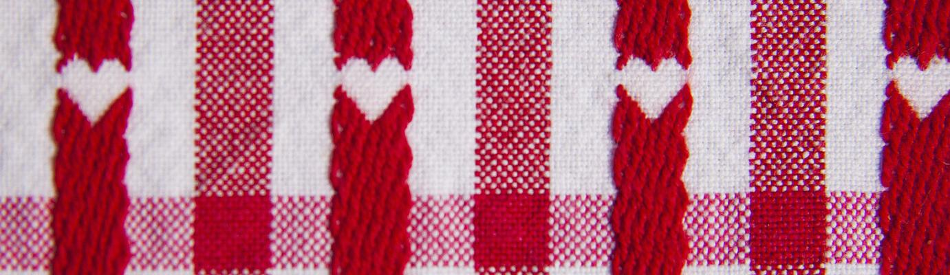 Red and white fabric with a heart pattern.