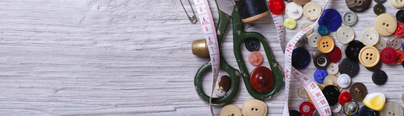 Scissors, buttons and tape measure.