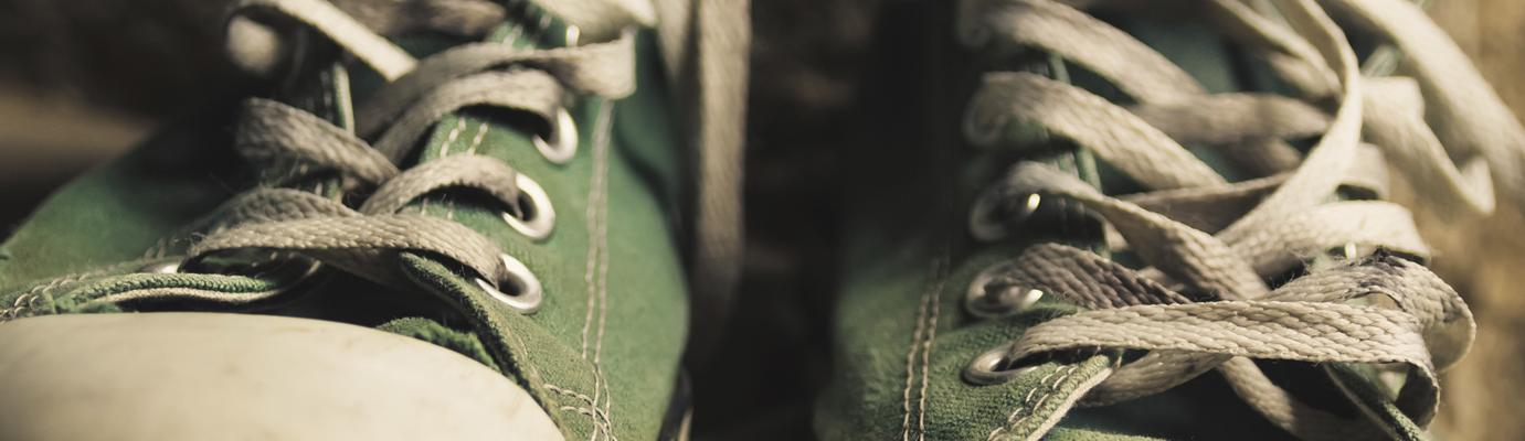 A pair of green trainers.