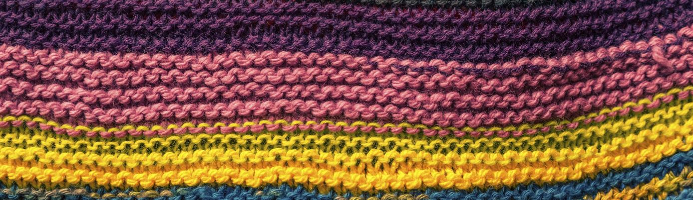 Colourful woolly knitted fabric.