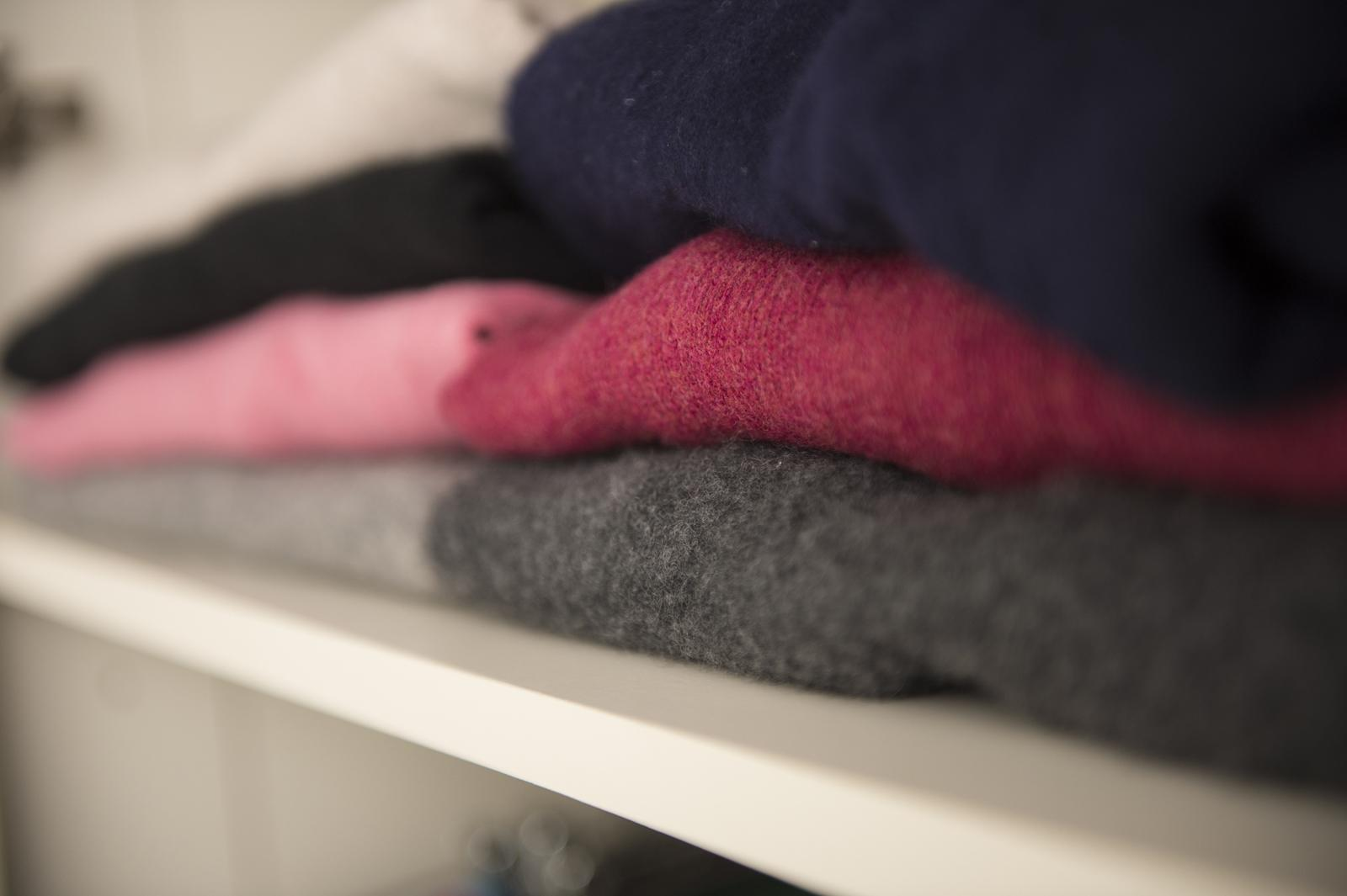 Jumpers on a shelf