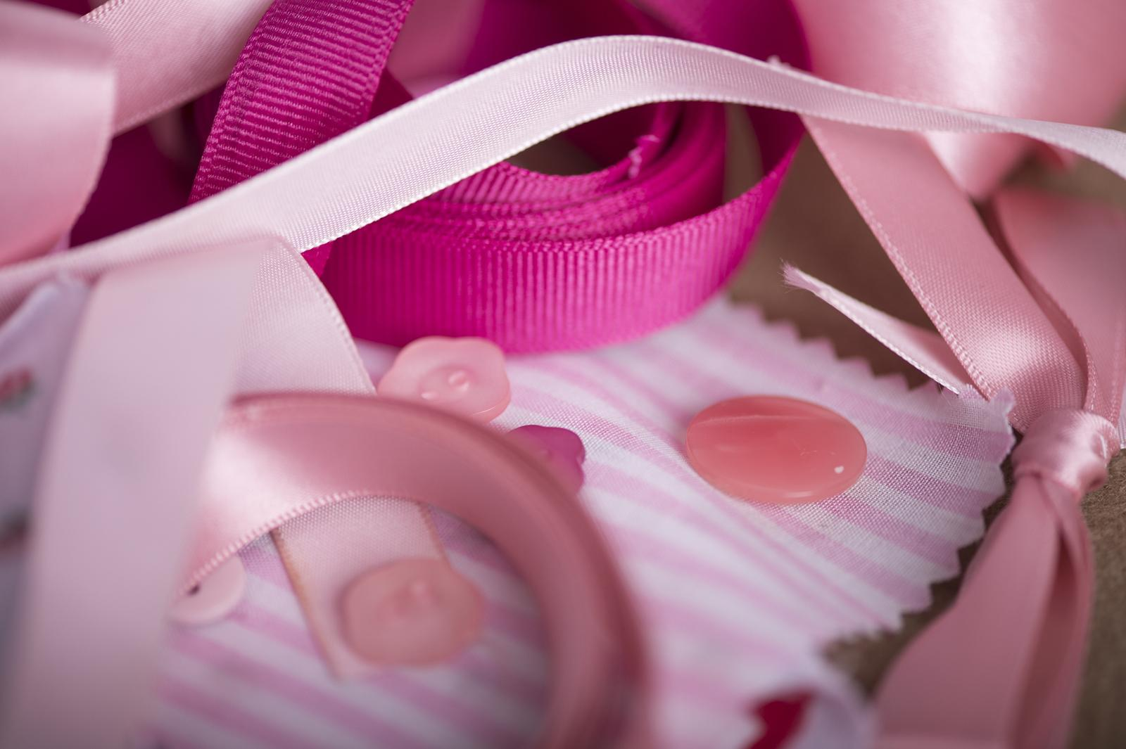 Pink ribbons and buttons.