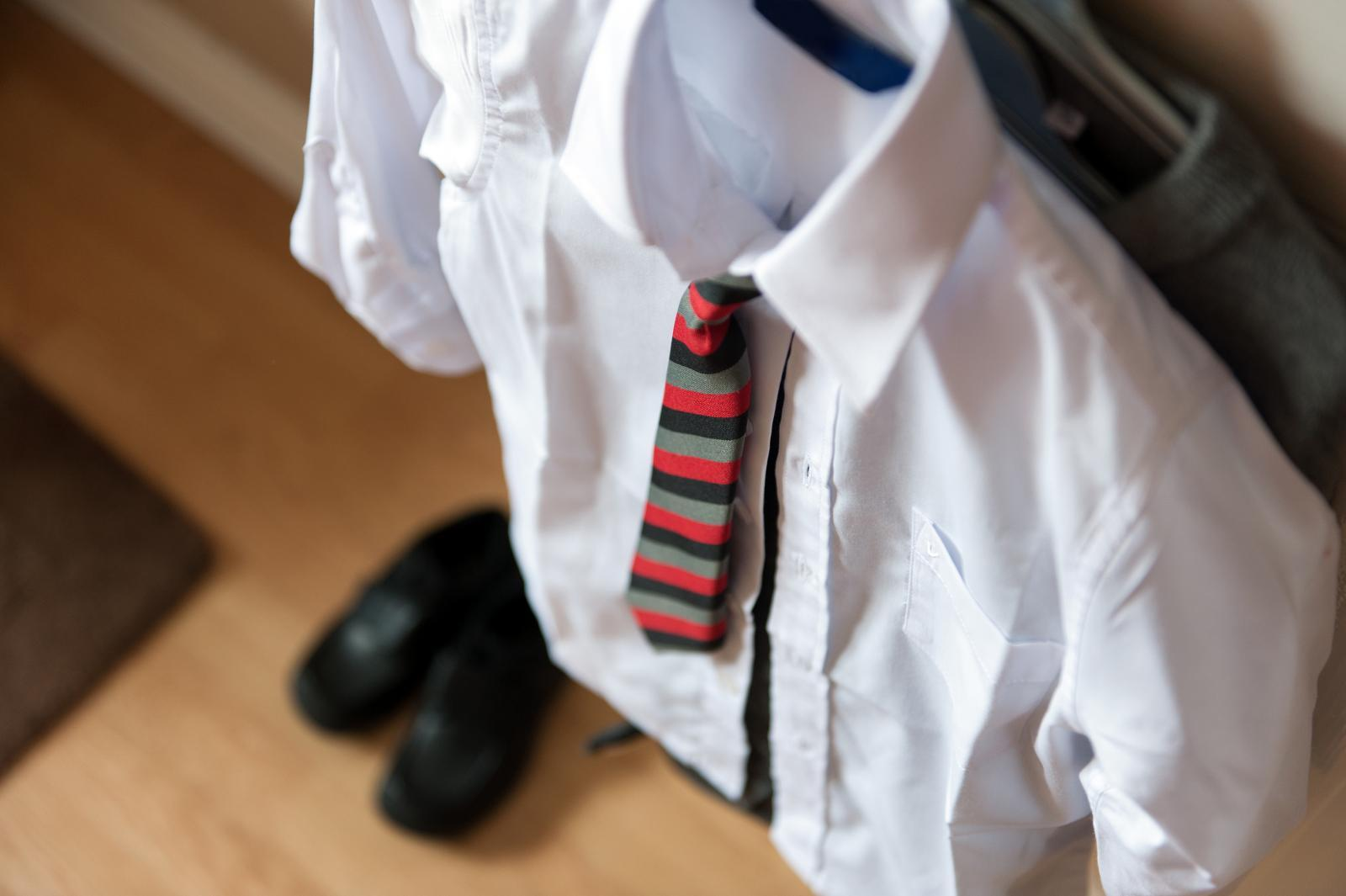 School uniform hanging up - shirt and tie