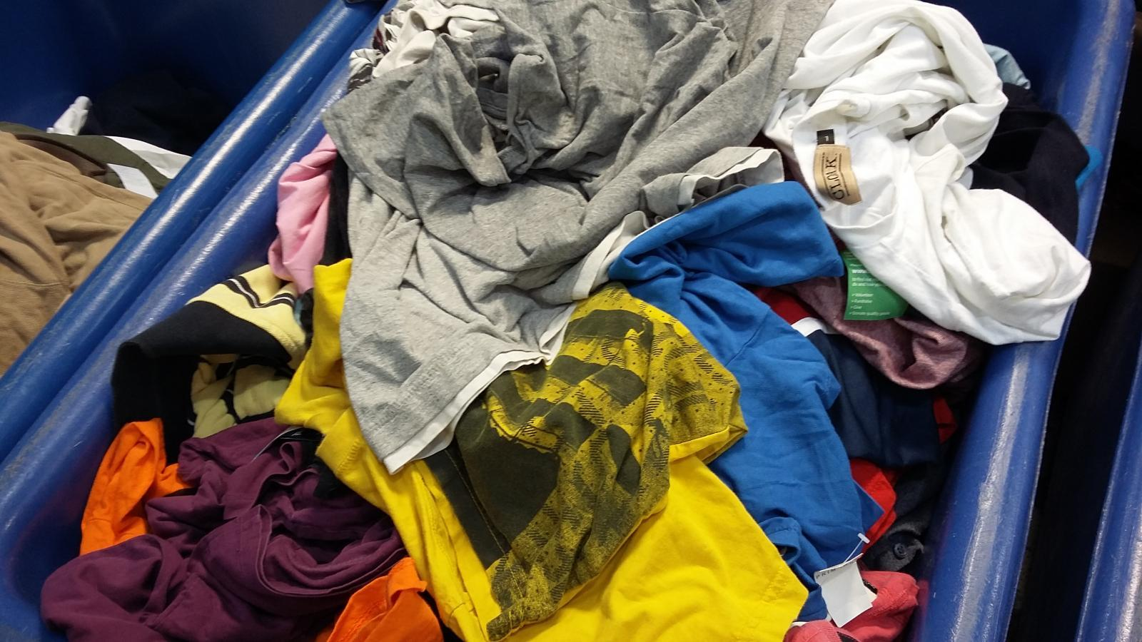 A pile of folded t-shirts.