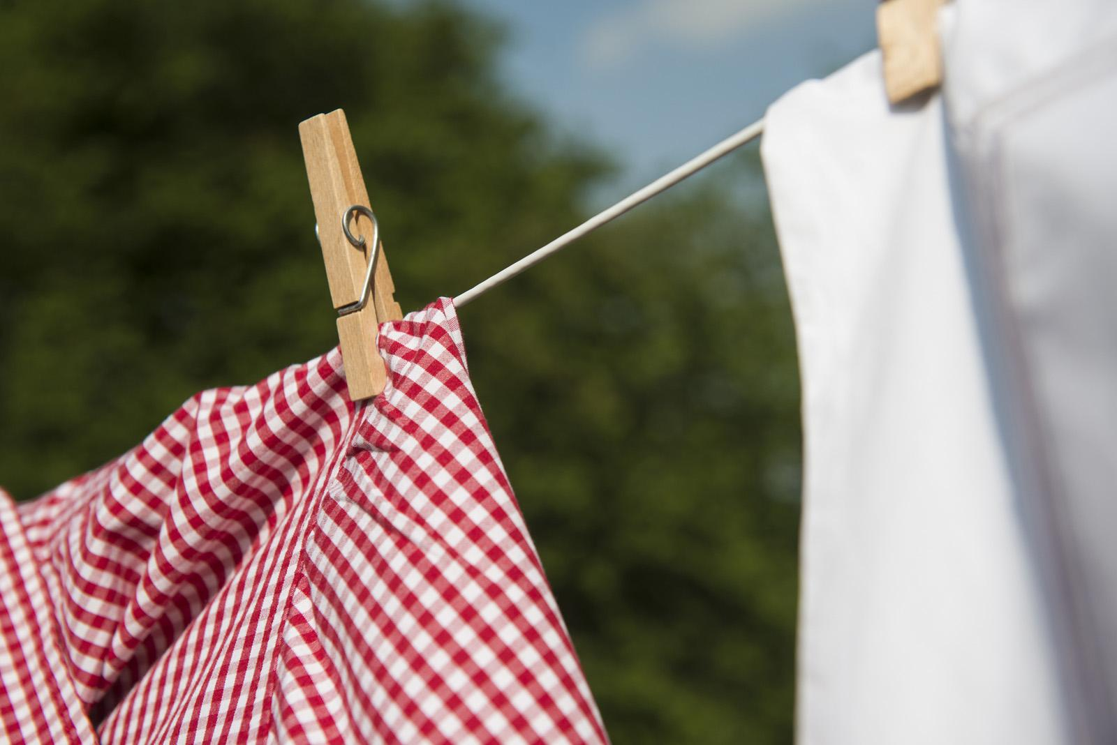 Clothes drying outside on a washing line.
