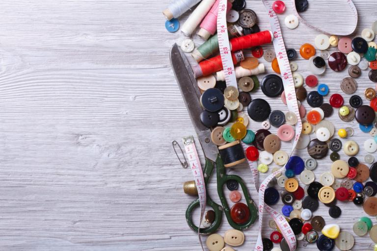 Scissors, buttons and other sewing items.