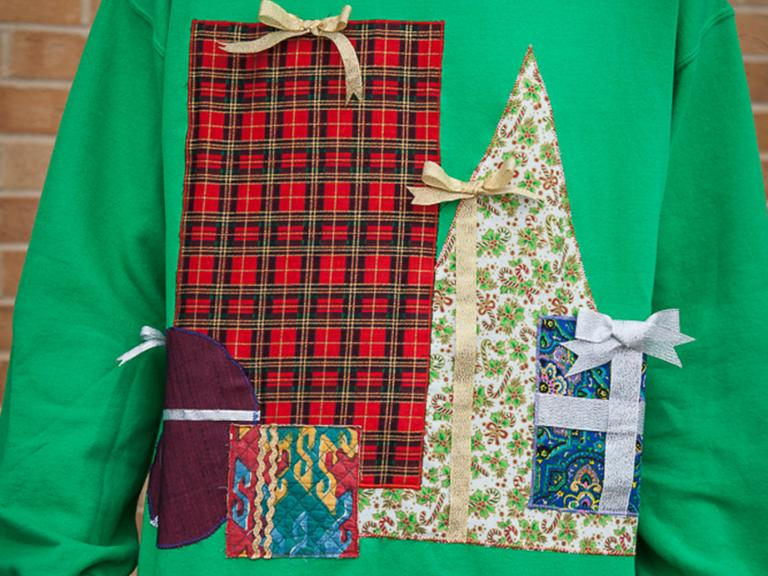 Christmas sweatshirt decorated with presents.