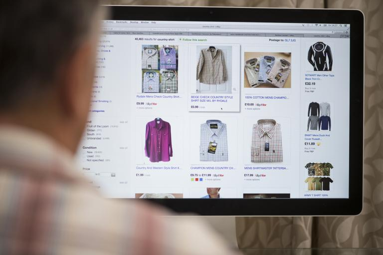 Computer screen with website showing clothes for sale.