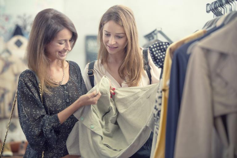 Two women comparing notes on clothes.