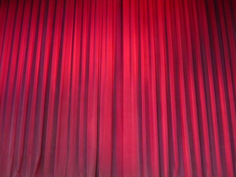 A red velvet curtain.